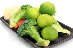 Установленные лимоны и овощи Стоковое фото RF