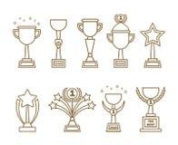 Установленные чашки наград значков иллюстрация вектора
