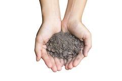 Установленная сухая почва в руке Стоковые Фотографии RF