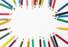 установленные карандаши предпосылки цветастые белыми стоковая фотография rf