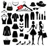 Установленные одежды и женщины с хозяйственными сумками Стоковые Фото