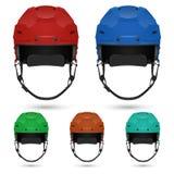 Установленные шлемы хоккея на льде, изолированный на белизне Стоковое фото RF
