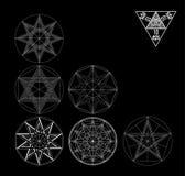 Установленный священный комплект вектора элементов конспекта геометрии изолированный на черной предпосылке Стоковое фото RF
