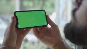 Устройство, экран с зеленым экраном Smartphone с chromakey сток-видео