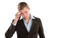 Усугубленный бизнесмен пробуя держать его совместно - изолированный Стоковые Фотографии RF