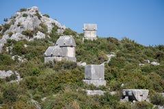 Усыпальницы Lycian в Kalekoy Simena, Турции Стоковые Изображения