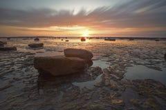 Утесы и заход солнца Стоковое Изображение