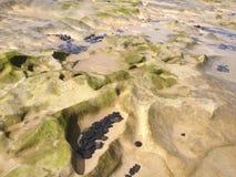 Утесы и песок Стоковые Фотографии RF