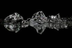 Утес льда на черноте отражения Стоковые Фото