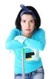 Утомлянная и вымотанная женщина чистки Стоковое Изображение