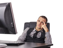 Утомленный бизнесмен перед его компьютером стоковое фото rf