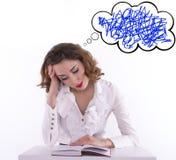 Утомленный студент женщины с книгой Стоковая Фотография
