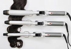 Утюг волос завивая с расширением волос Стоковая Фотография