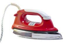 Утюг красного цвета на белой предпосылке Стоковое фото RF