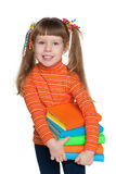 Ухищренная маленькая девочка держит книги Стоковая Фотография RF