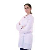 Ученый женского доктора ассистентский в белом пальто над изолированной предпосылкой Стоковое фото RF