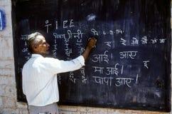 учитель детей учит Стоковые Изображения