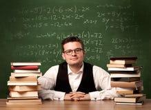 Учитель математики на столе Стоковые Фото