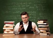 Учитель математики на столе Стоковые Фотографии RF