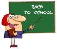 учитель chalkboard женский указывая к Стоковые Фото