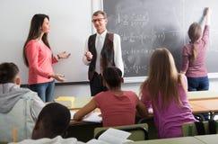 Учитель и студент около доски Стоковое фото RF