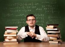 Учитель математики на столе Стоковая Фотография