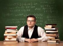 Учитель математики на столе Стоковое Фото