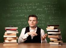 Учитель математики на столе Стоковые Изображения