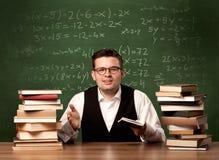 Учитель математики на столе Стоковое Изображение