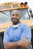 Учитель перед школьным автобусом стоковые фото