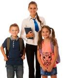 Учитель при дети школы изолированные над белой предпосылкой Стоковое Фото