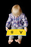 учить ребёнка прочитанный к Стоковое Фото