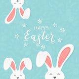 Уши кролика на голубой предпосылке с картиной и текстом счастливым Easte Стоковое Фото