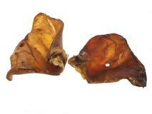 Собачья еда ушей свиньи Стоковые Фотографии RF