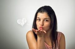 дуя поцелуй Стоковые Фото
