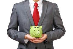 удерживание бизнесмена банка piggy Стоковое фото RF