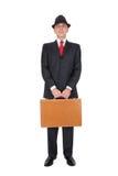 удерживание бизнесмена портфеля коричневое Стоковые Фотографии RF