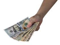 Удерживание руки долларовых банкнот белизна изолированная предпосылкой зажим Стоковые Фото