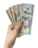 Удерживание руки долларовых банкнот белизна изолированная предпосылкой зажим Стоковая Фотография