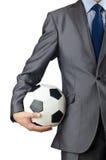 удерживание футбола бизнесмена Стоковые Изображения RF