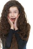 Удивленная школьница с темнотой Стоковая Фотография RF