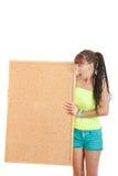 Удивленная девушка держа пустой знак Стоковое фото RF