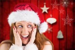 Удивленная женщина в костюме santa против цифров произведенной предпосылки Стоковое фото RF