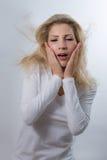 Удивленная красивая белокурая женщина Стоковые Фото