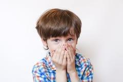 Удивленный мальчик на белой предпосылке Стоковая Фотография