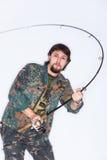Удивленный рыболов с штангой Стоковые Фотографии RF