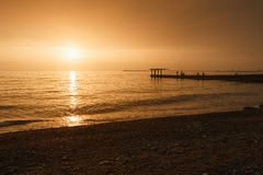 Удить в заходе солнца Стоковое Изображение RF