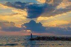 Удить на заходе солнца стоковое изображение