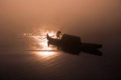 Удить на зоре Стоковая Фотография