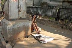 улицы kolkata попроек нищенских стоковое фото rf